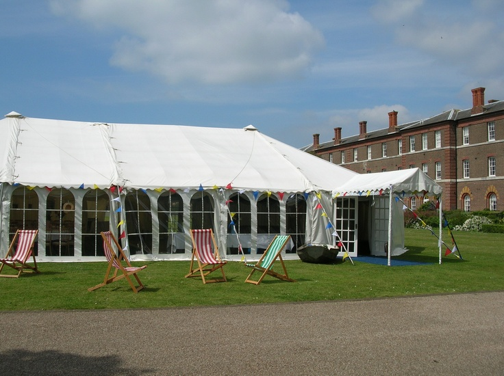 Deck chairs outside this wedding marquee on the sea front in Southsea, Hampshire, UK.