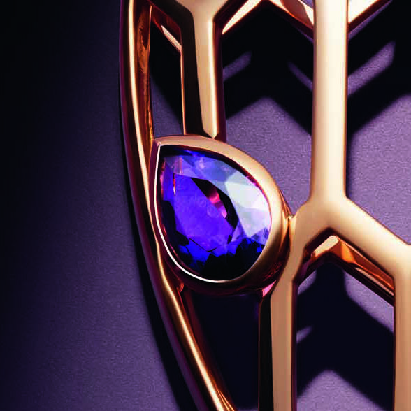 Close up of the new Bulgari Serpenti Seduttori pendant necklace in rose gold with amethyst eyes.