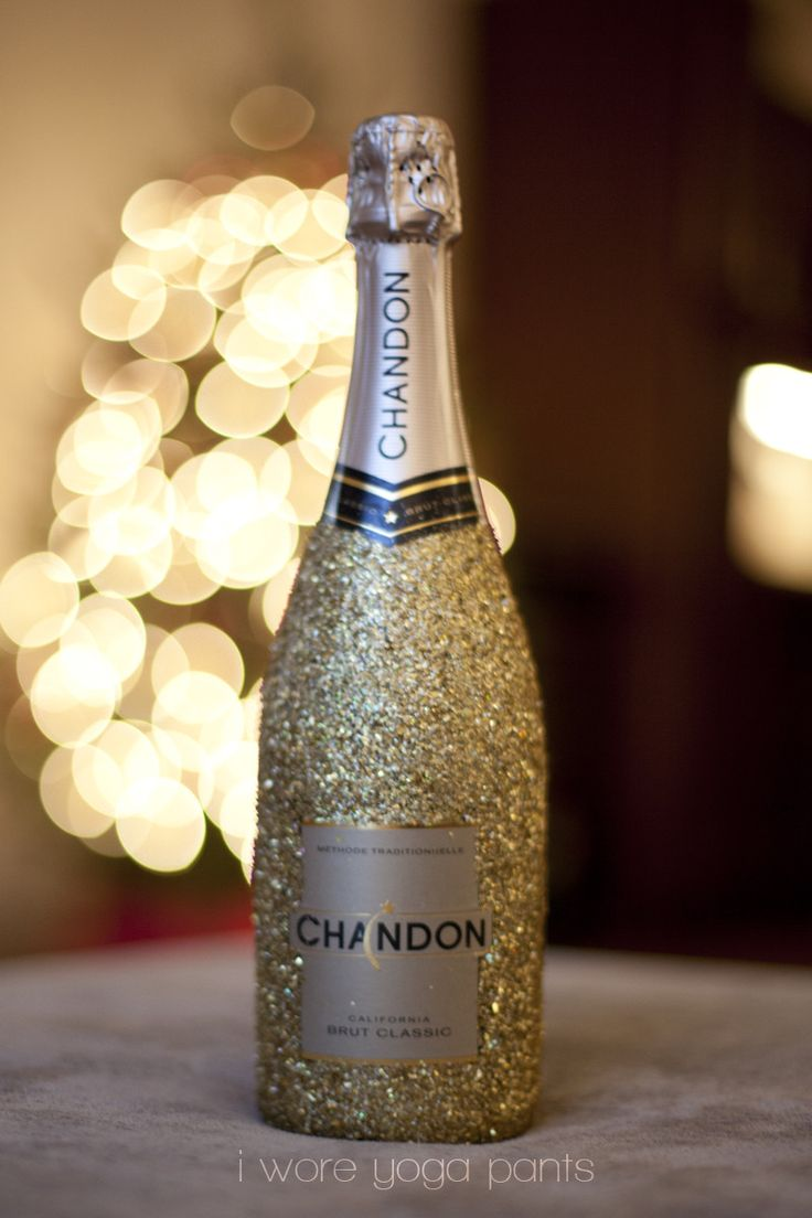 Something to drink...   a DIY Glitter Champagne Bottle using Modge Podge (water based sealer, gloss and finish) and high gloss finish. French champagne a must!