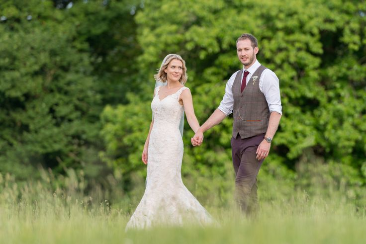 Photo of bride and groom in the Chilham castle estate, Kent. Photo by Mugshot Photography