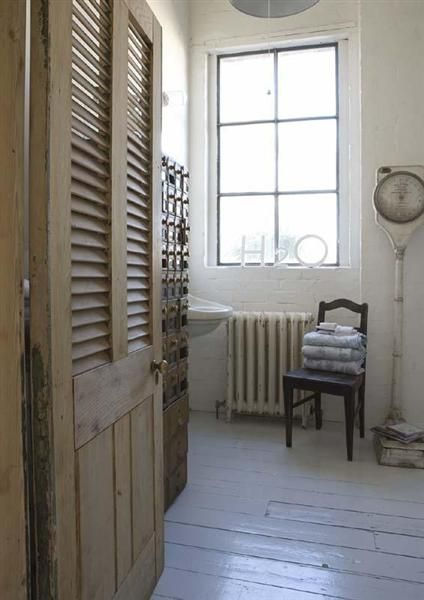 I wish I could see all of that apothecary cabinet that's peeking around the door!: Wooden Chairs, The Doors, Rustic Bathroom, Houses Ideas, Shutters Doors Interiors, Upstairs Bathroom, Bathroom Shower, Paintings Floors, Dreamy Bathroom