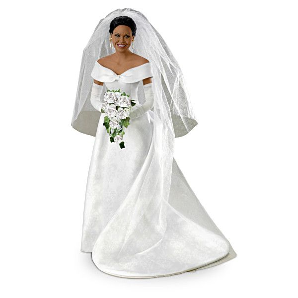 "Michelle Obama Commemorative Bride Doll, 16"". Handcrafted bisque porcelain poseable doll commemorates Michelle Obama's wedding day. Authentically styled gown and replica jewelry."
