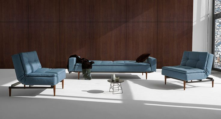 Create a playful living room by combining sofa bed and chairs.