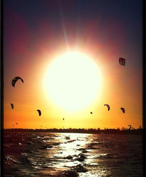 Kite surfing at Altona Beach, Vic.