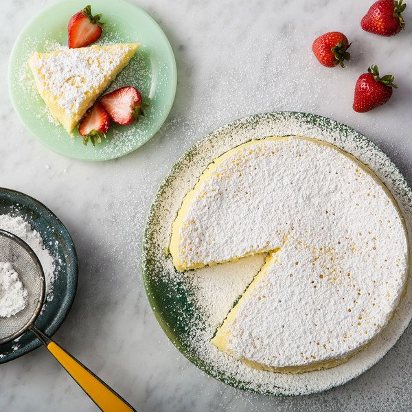 This basic cheesecake is one part souffle, one part custard, resulting in a lightly sweet and airy cake that is super simple to make.