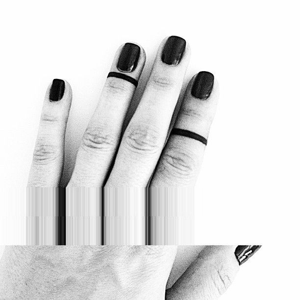 I like the bands on the upper part of the finger, by far my fav of the finger tattoo
