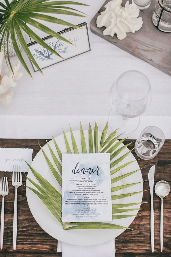 Add some natural elements to each place setting. A clean palm frond across every plate is a beautiful touch. | Photo Credit: Max & Friends