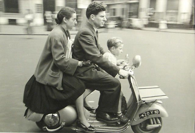 Robert Doisneau (French, 1912-1994); French Family on Two Wheel Scooter;