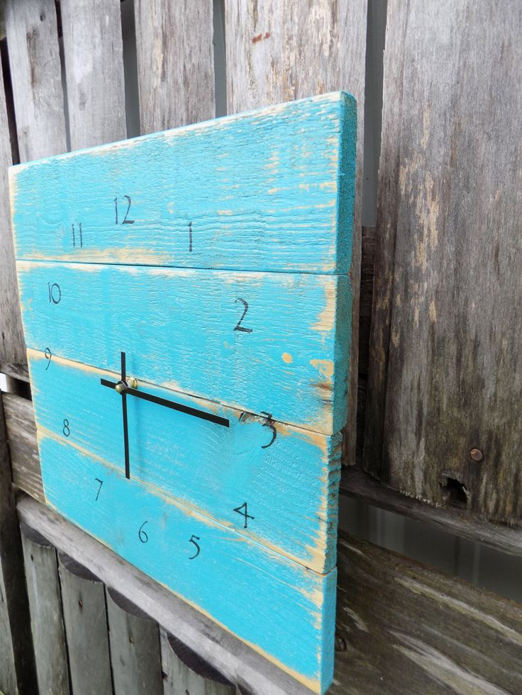 This beach style clock is painted in turquoise, then distressed for the perfect rustic charm. Rugged style black numbers, and straight black modern clock hands finish this primitive clock. ** Clock me