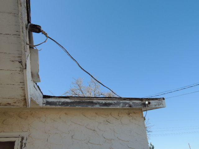 Exposed garage feeder wiring.