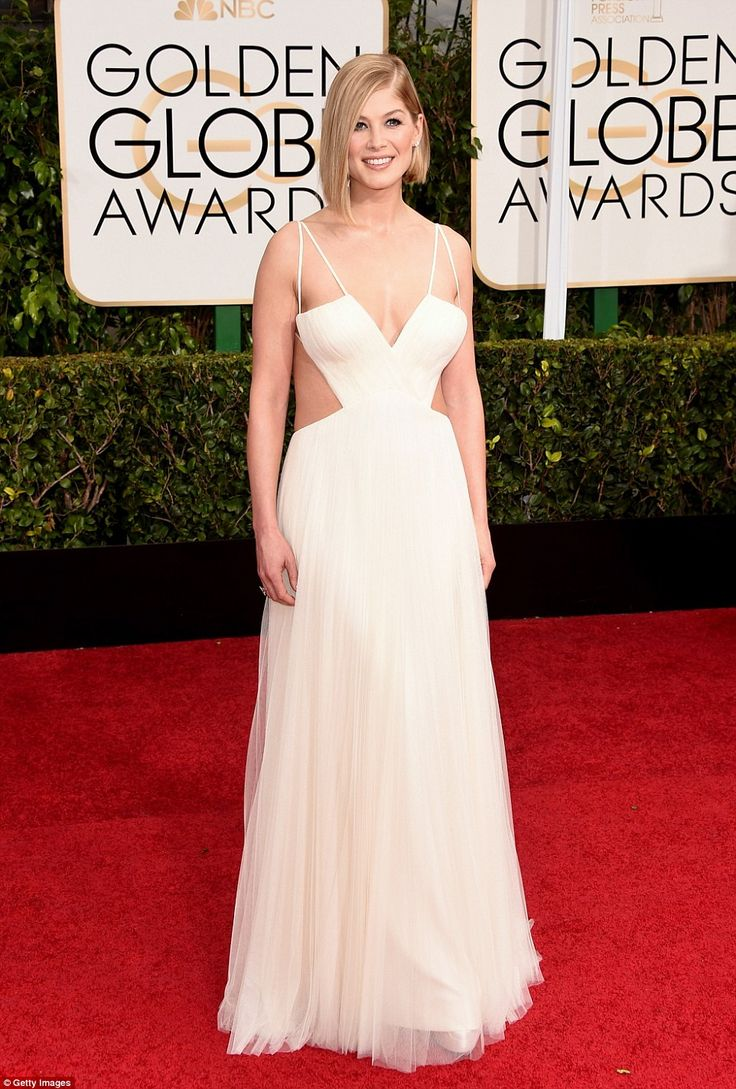 Cut-out: Rosamund Pike leads the Brit invasion on the red carpet as she attends the 72nd Golden Globes awards in Los Angeles