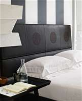 Erik embroidered bedboard for B&B Italia embroidery on leather