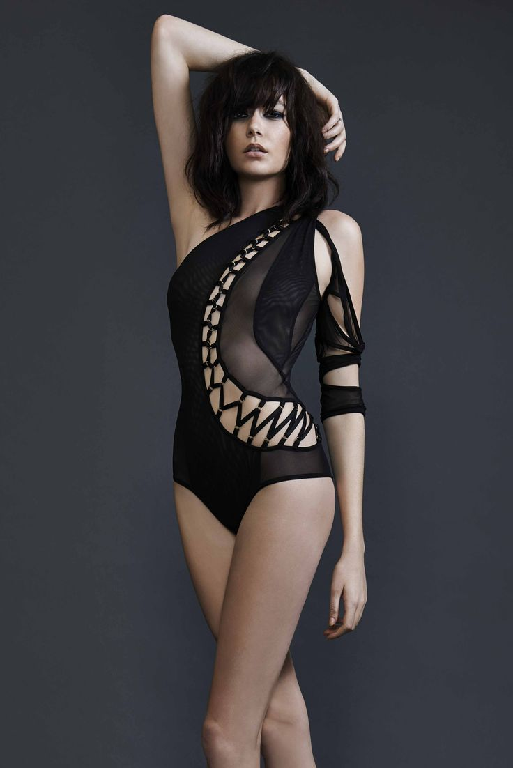 Asymmetric black mesh bodysuit with cutouts                                                                                                                                                                                 More