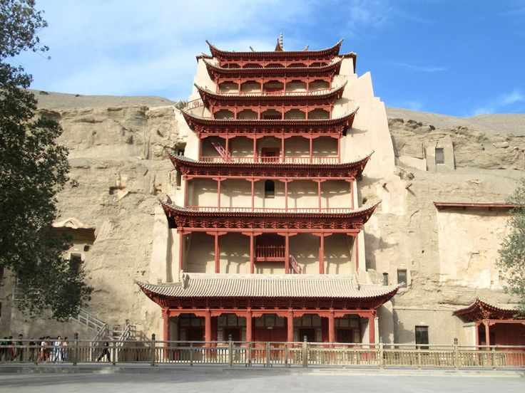 A seven-story pagoda.at Cave 96 at the Mogao Caves southeast of Dunhuang, Gansu, China, shelters a remarkable 35.5-meter-hgih statue of Buddha dating from 695 AD.