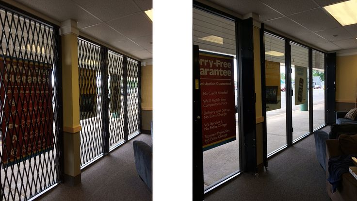 """Storefront security with 98"""" high powder coated black keyed alike security gates. there when you need them......gone when you don't."""