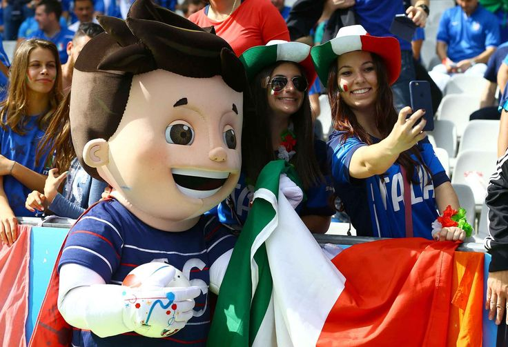 Editorial use only. No merchandising. For Football images FA and Premier League restrictions apply inc. no internet/mobile usage without FAPL license - for details contact Football Dataco Mandatory Credit: Photo by Kieran McManus/BPI/REX/Shutterstock (5737483n) Italy fans take a selfie with the mascot during the UEFA Euro 2016 Round of 16 match between Italy and Spain played at Stade de France, Paris, France on June 27th 2016 Football - UEFA European Championships 2016 Round of 16 Italy v…