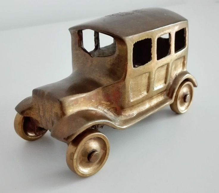 vintage metal bronze antique car miniature toy vehicle retro spinning wheels