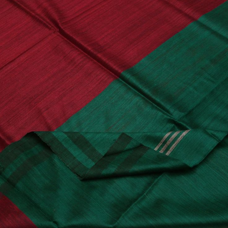 #Handwoven Soft Tussar Bhagalpuri Silk Sari in Red & Green Panels ~ This vibrant soft tussar from Bhagalpur displays broad panels of deep tomato red and emerald green, with verticle jute lines in centre. The colours are tinged with black, lending it sophistication. The border is two bands of darker body colours tinged with black. The smart pallu with its broad panels is indeed something to reckon with! Sari Code 970512281