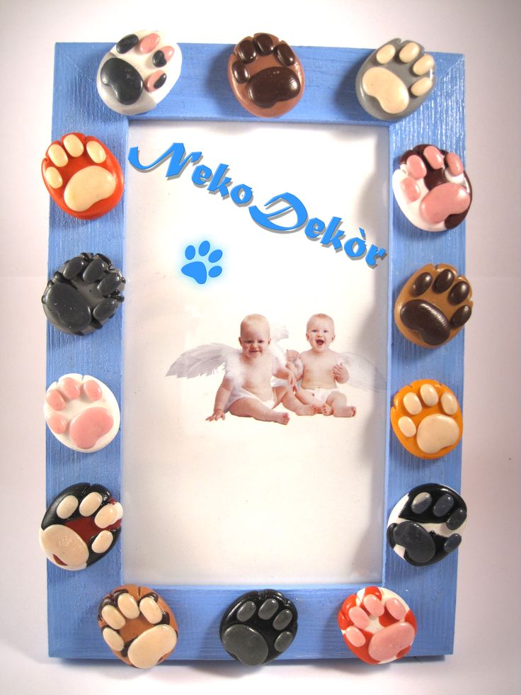 Size: Width 10,5 cm / Height 15,5 cm  Wodden frame with many different handmade fimo cat paws.