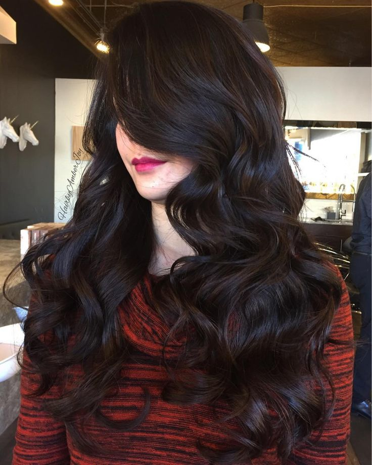 Dark chocolate Balayage, sweeping layers and a bouncy cascading curl to finish.