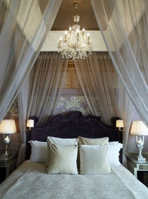 Master bedroom...love how romantic this looks. I love the idea with the chandelier above