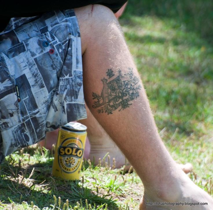 Man with an Australian coat of arms tattoo on his leg at Bondi Beach, Sydney in November 2010