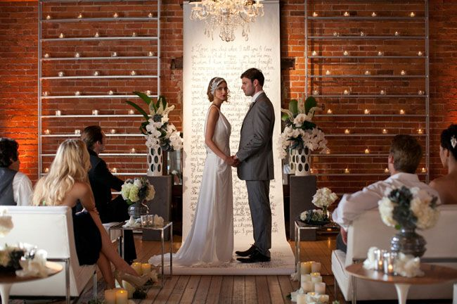 Handwritten aisle runner also acts as a backdrop (unconditional altar) for the ceremony. Love the height of it and the candle wall to the right / left