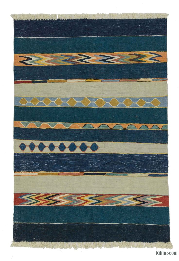 Beautifully transform your living space with our handmade, authentic and timeless new kilim rugs that carry with them many of the traditional elements that made true vintage Turkish Kilim rugs so precious. Each kilim is skillfully hand-woven in Turkey to create a beautiful piece of art. We use vegetable dyed and hand spun wool to make sure they age gracefully.This fine blue rug measures 3'4'' x 4'10'' (40 in. x 58 in.). We can customize it by adding your monogram or removing the fringes upo…