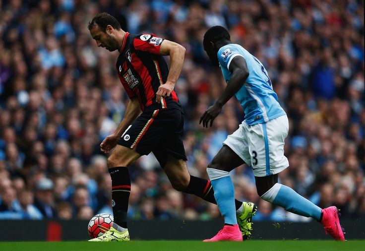 Glenn Murray of Bournemouth and Bacary Sagna of Manchester City compete for the ball during the Barclays Premier League match between Manchester City and A.F.C. Bournemouth at Etihad Stadium on October 17, 2015 in Manchester, England. (Oct. 16, 2015 - Source: Dean Mouhtaropoulos/Getty Images Europe)