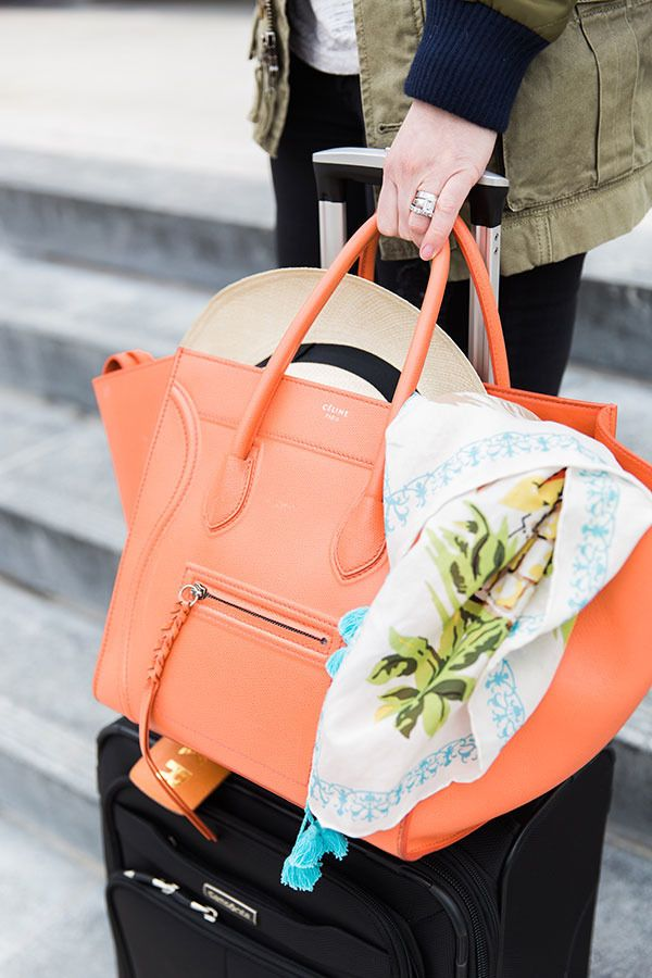 A bright coloured tote is the perfect summer travel accessory to add a pop of colour to resort wear.