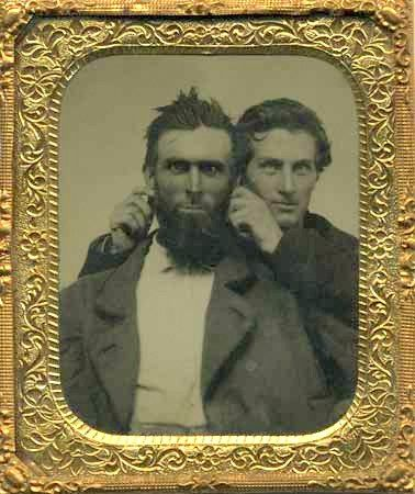 ca. 1860s-90s, [tintype portrait of two men messing around] via Jeremy Rowe Vintage Photography