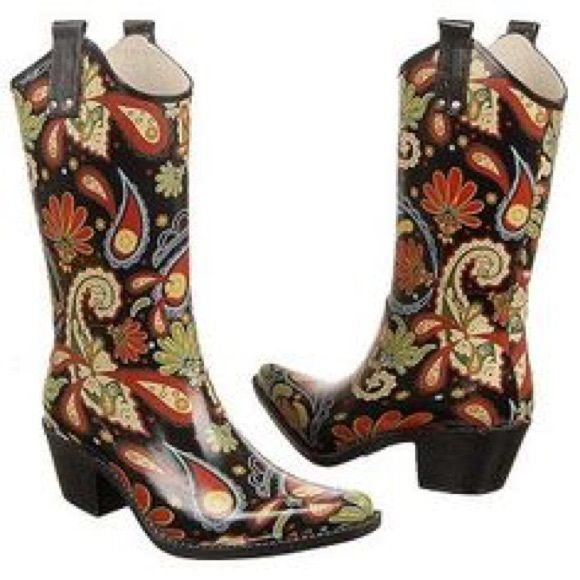 Nomad Women's Western Rain Boots size 7 Yippy These boots are in great used condition. Yippy style with paisley print.                             Product Description Giddy up in this traditional cowboy style rain boot. The Yippy is made with water resistant rubber and a non-slip sole. Friendly side-note: Nomad rain boots are intended for general wear, not for sport or utility. They will keep your feet dry in regular wet conditions, use in heavy snow terrain is not recommended Nomad Shoes…