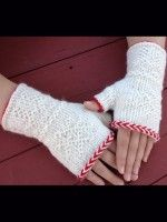 """Textured Twined Fingerless Mitts: Learn the fascinating Swedish technique of Tvåändsstickning, or twined knitting by creating one of a pair of fingerless mitts. Working in the round, the techniques covered include: twine knitting, twine purling, the crook stitch, the """"O"""" stitch, reading a chart, and the Chain Path, the twined knitted increase, an asymmetrical thumb gusset, and traditional motifs. The Herringbone Braid is an optional addition."""