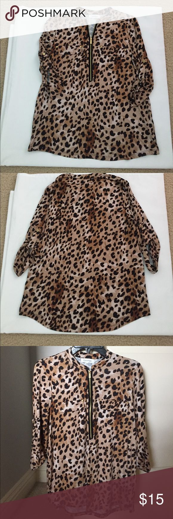 Calvin Klein Cheetah print shirt 🐆🐆 SZ S Calvin Klein Cheetah print shirt Size Small.  Gold zipper in the front with some gold detail on each pocket.  Sleeves can be left down or buttoned up.  Fun Shirt😀🐆 Calvin Klein Tops
