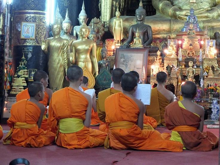 A prayer in Luan Prabang | Just a Backpacker