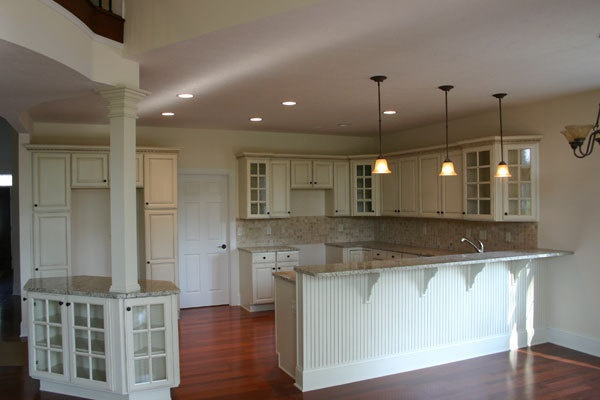 Caruso 39 s cabinets white cabinets with mullion doors - Wainscoting kitchen cabinets ...