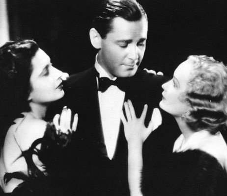 Herbert Marshall with adoring Kay Francis and Miriam Hopkins.