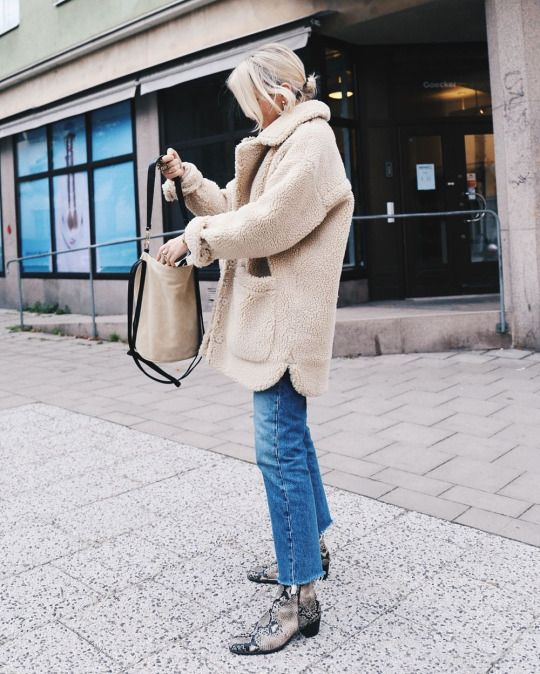 Cozy jacket, jeans, and snakeskin boots                                                                                                                                                                                 More