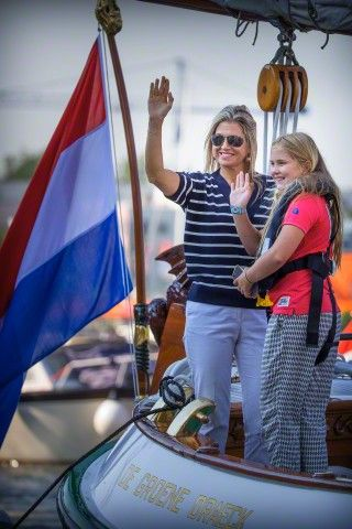 Queen Maxima and Crown Princess Amalia sail on the Groene Draeck during Sail 2015 in Amsterdam, The Netherlands, 22 August 2015.