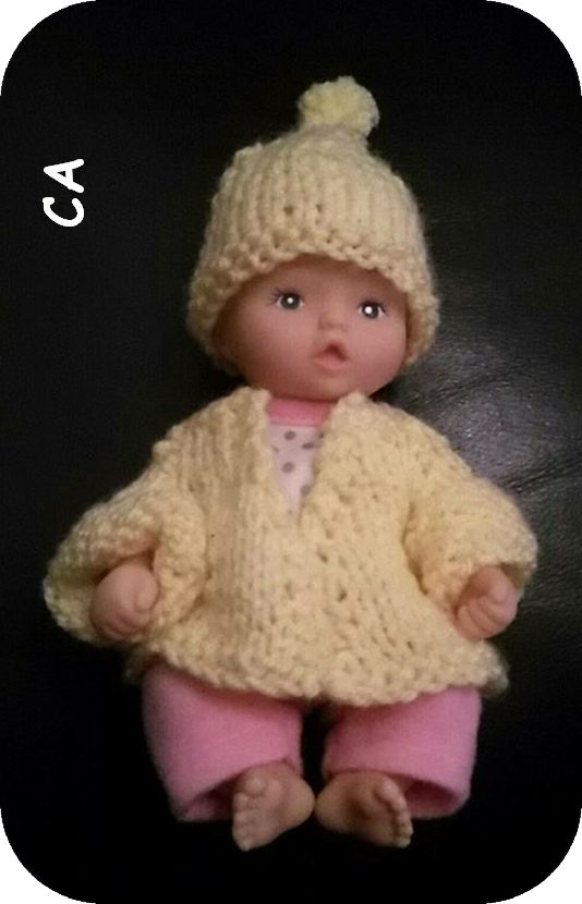 Designed by our resident fashion designer, Stevie, this matching cardigan and hat set will keep your mini baby doll snug for her shoebo...