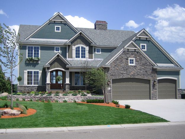 This 4 bedroom home features a large two story great room for Home designs traditional
