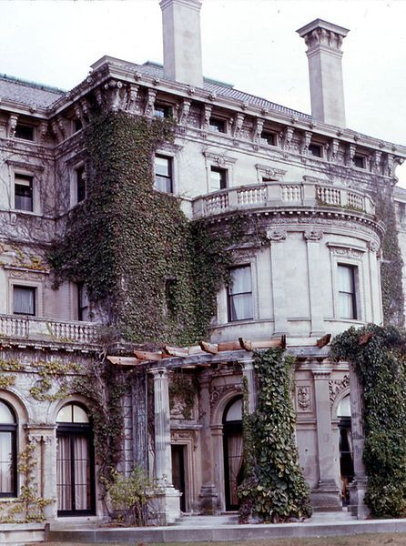 Breakers side view,The Breakers was built as the Newport summer home of Cornelius Vanderbilt II, a member of the wealthy United States Vanderbilt family. It is built in an Italian Renaissance style. Designed by renowned architect Richard Morris Hunt and with interior decoration by Jules Allard and Sons and Ogden Codman, Jr., the 70-room mansion encompasses 138,300 square feet of space on five floors. The home was constructed between 1893 and 1895