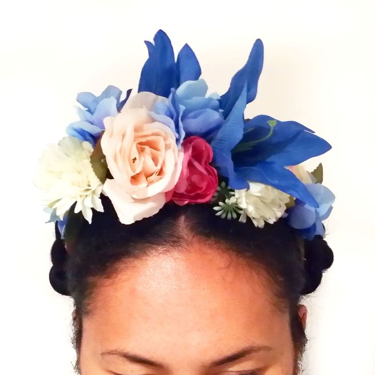 i have succumbed to the Frida Kahlo hair style (just because she is COOL) and have made these in the still of the weekend night!GO BIG OR GO HOME! A few less flowers but bigger and bolder then ever... Made with artificial paper and fabric flowers, with ribbon tying all in. HOORAY you can wear it more then once.. actually forever.Shades of Blue Lily / Blush Roses