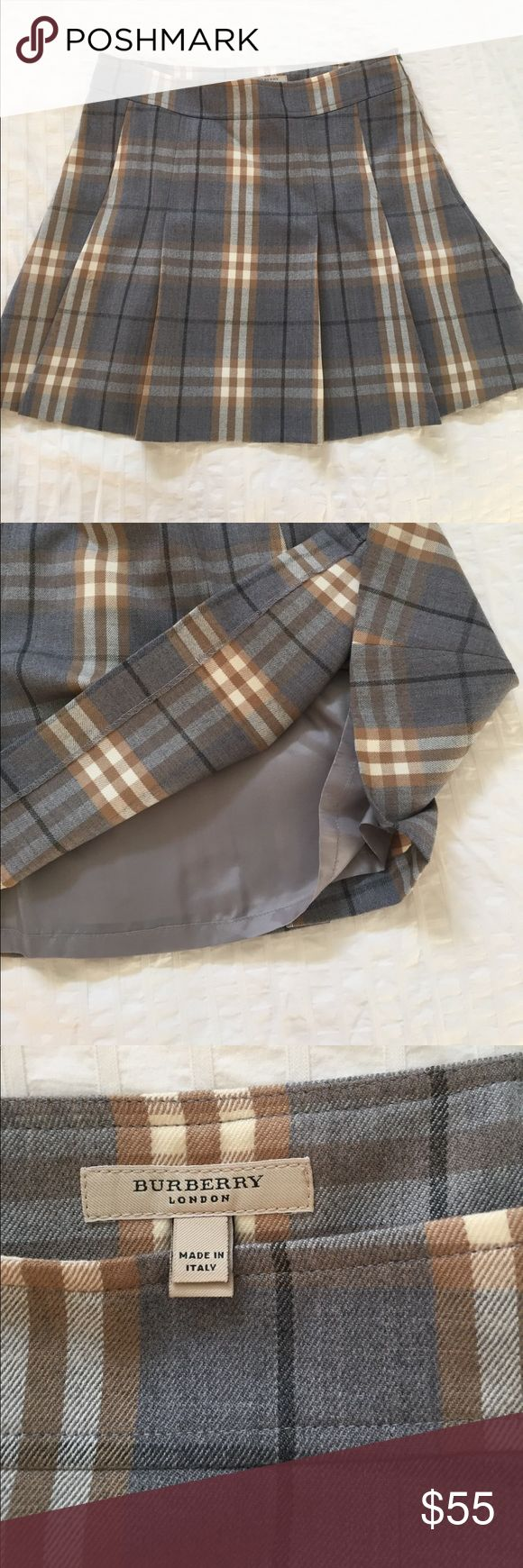 Burberry pleated 100% wool skirt Signature Burberry plaid wool pleated skirt, gently used, small coffee spot that could be removed with some TLC (not noticeable currently, with the pattern you have to look very closely to see it).  Would look adorable with black tights in winter! Make me an offer! Burberry Skirts Mini
