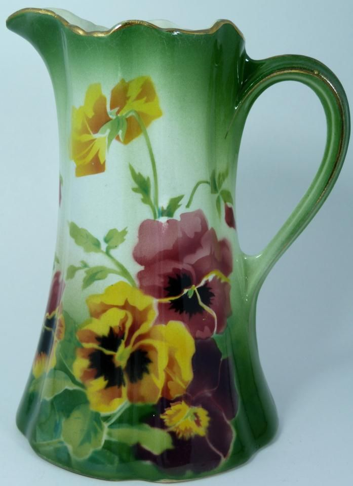 FRENCH PORCELAIN HAND PAINTED FLORAL PITCHER.
