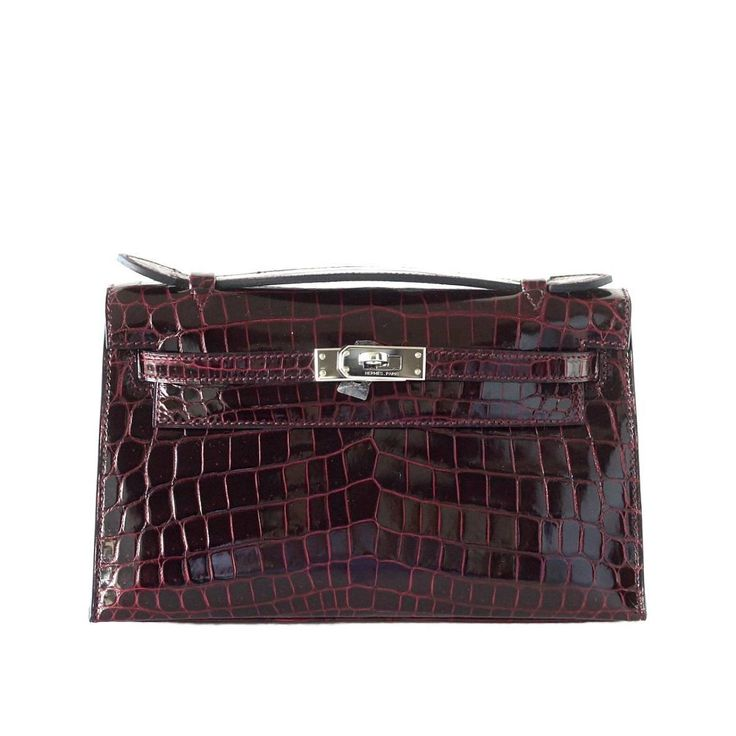 HERMES Kelly Tiny Pochette Clutch Bag Rare Bordeaux Crocodile Palladium | From a collection of rare vintage clutches at https://www.1stdibs.com/fashion/handbags-purses-bags/clutches/