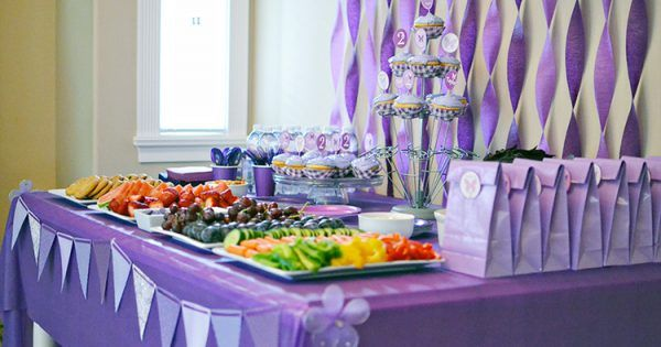 Purple is my daughter's absolute favorite color, so for her 2nd birthday I threw her a purple birthday party. She was in heaven.  All of the party decorations and supplies were from the dollar store, Walmart, and Michael's Craft store. I couldn't find any purple party supplies in the dollar...