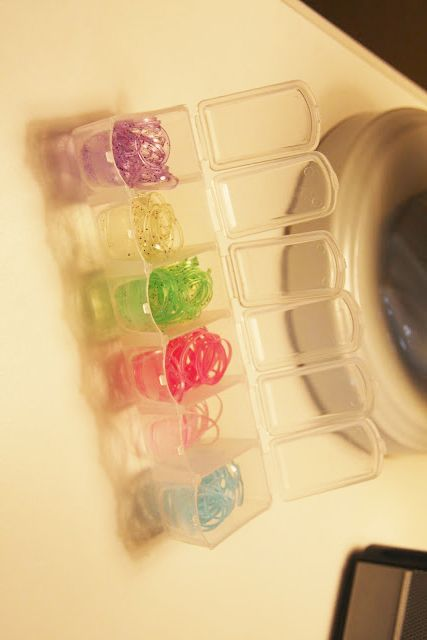 A weekly pill organizer is a great way to organize small elastic hair ties.