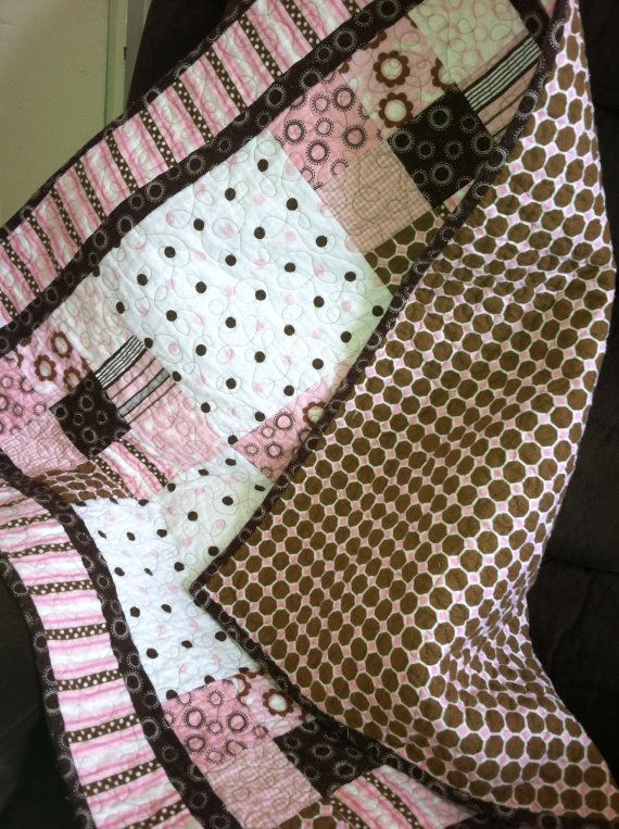 Baby girl quilt in pink and brown cotton flannel. by annmoody