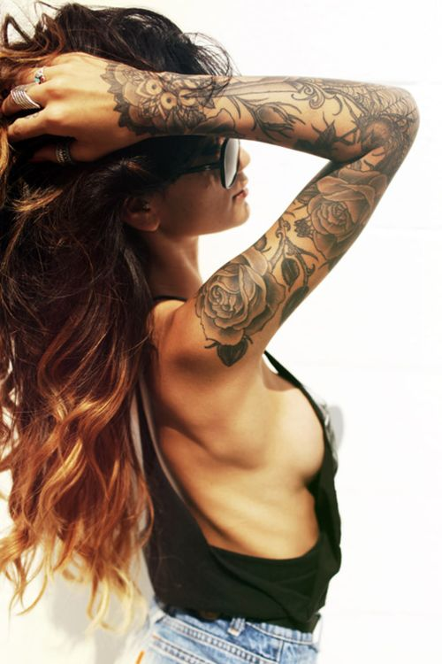 sleeve tattoo. Loving no color and that it goes on the top of her hand